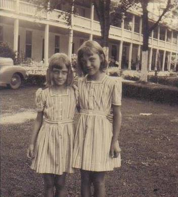 Mary Hudson and her sister, Peggy in front of the Donoho in by-gone days.